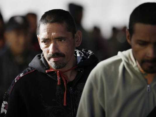 Javier Montes waits in line for a meal on Nov. 19, 2014, at the Padre Chava migrant shelter after being deported back to Tijuana, Mexico from California.