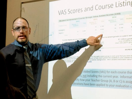 La Plata Middle School Principal Louis Alvarez discusses the state's teacher evaluation system on Tuesday at the Silver Consolidated Schools Board of Education meeting. Randal Seyler - Sun-News