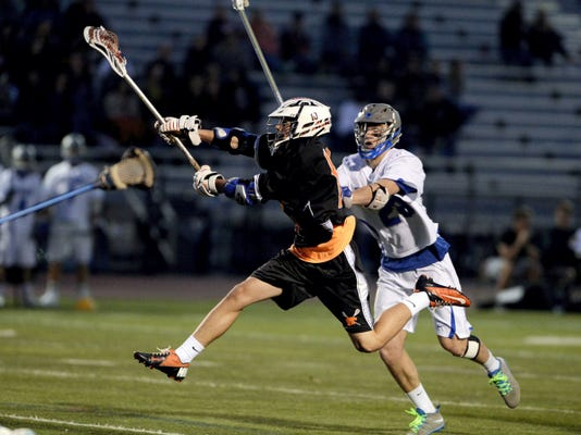 Palmyra's Eric Thomas flies through the air as he finds the back of the net against Cedar Crest's Christian Brightbill during the game at Earl Boltz Stadium on Friday, April 17, 2015. Palmyra led 8-4 at the half. Jeremy Long -- GameTimePA.com