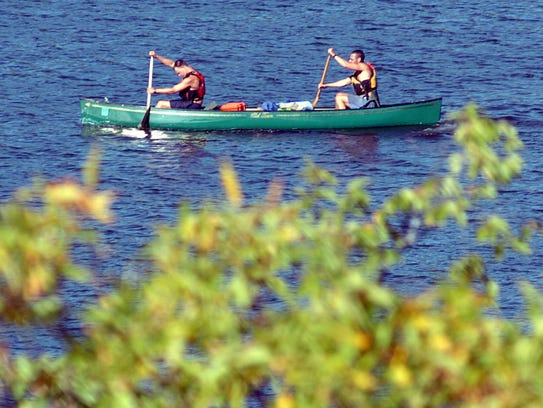 Canoeists paddle on the Mississippi River in St. Cloud.