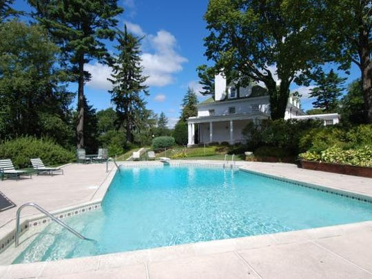 The pool at 2 Cooper Road, a gracious Scarsdale estate that is now for sale.