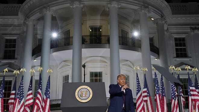 President Donald Trump gestures as he finishes his acceptance speech from the South Lawn of the White House on the fourth day of the Republican National Convention, Thursday, Aug. 27, 2020, in Washington.