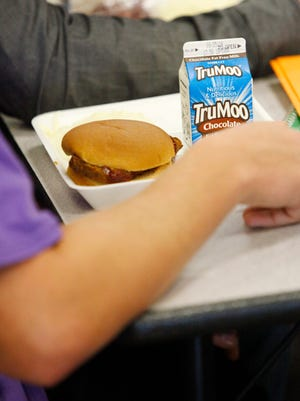 Students eat lunch at Central High School.