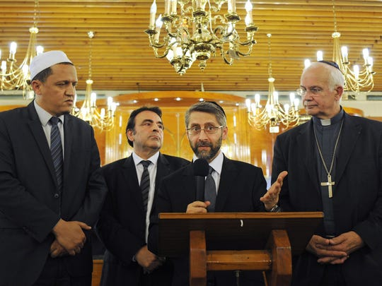 From left, Imam Hassen Chalghoumi; Joel Mergui, president of the Central Jewish consistory of France; Haim Korsia, the great rabbi of France; and Bishop Stanislas Lalanne attend an ecumenical ceremony at the Synagogue of Sarcelles. The ceremony was held July 21 after a weekend marked by violence.