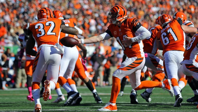 The Cincinnati Bengals provided plenty of offensive punch in Week 7 from running back Jeremy Hill (left) and quarterback Andy Dalton.