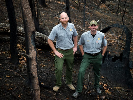 Park rangers Andrew Herrington, left, and Ryan Williamson used chainsaws to clear the Spur on the night of Gatlinburg wildfire.