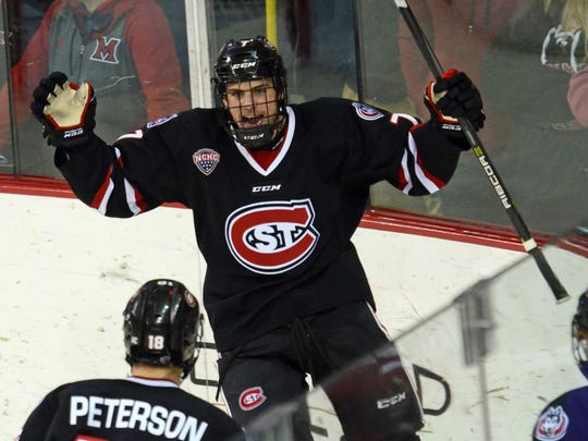 St. Cloud State's Nick Poehling celebrates his sixth goal of the season at 3:48 of the second period with teammate Judd Peterson on Saturday in Oxford, Ohio. The Huskies moved into sole possession of first place in the NCHC with the 4-0 win.