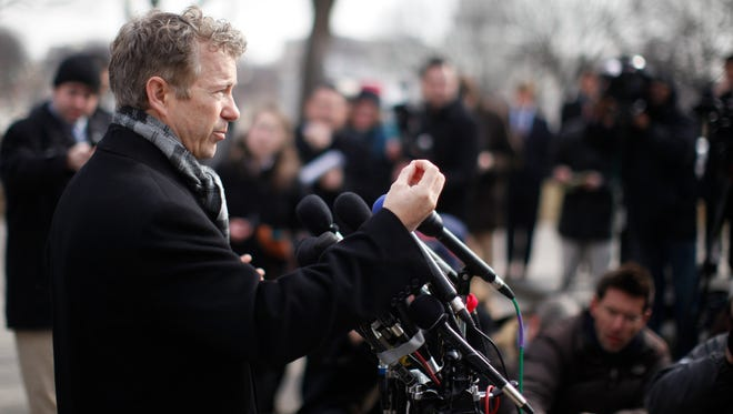 Sen. Rand Paul, R-Ky., speaks in front of federal court in Washington on Wednesday. Paul and a conservative political group are filing a lawsuit over the National Security Agency surveillance program.