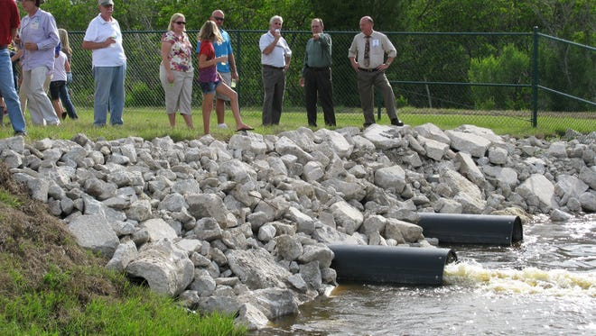 County officials demonstrate drainage pumps last week at the Pine Island Conservation Area on Merritt Island.