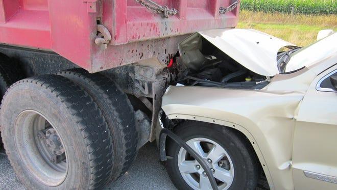 car versus dump truck