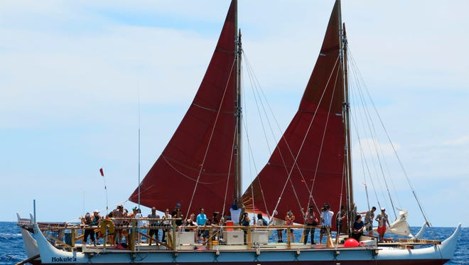 The Hokulea sailing canoe is seen off Honolulu. The Polynesian voyaging canoe is setting off on a three-year voyage around the world, navigating using no modern instrumentation.