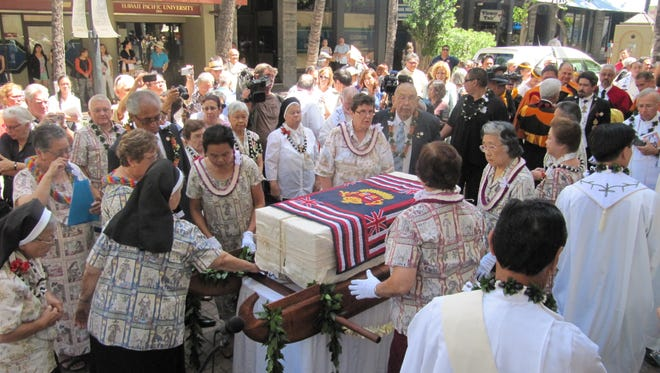 A casket containing the remains of St. Marianne Cope arrives at the Cathedral of Our Lady of Peace in downtown Honolulu for a ceremony and Mass in Honolulu, Thursday.