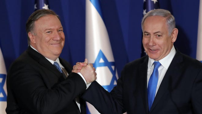 U.S. Secretary of State Mike Pompeo shake hands with Israeli Prime Minister Benjamin Netanyahu, during their visit at Netanyahu's official residence in Jerusalem, Thursday March 21, 2019. (Jim Young/Pool Image via AP)