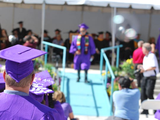 A student waits to be called to the stage during the