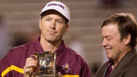 Dirk Koetter, left, hands the Territorial Cup to ASU President Michael Crow after a 28-14 win in 2006. Koetter was fired the next day after six seasons.