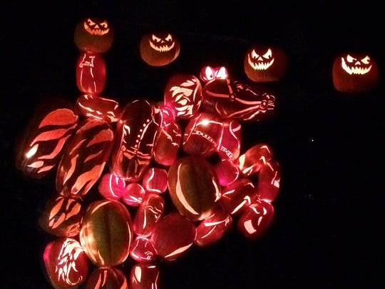 Headless Horseman carved from pumpkins at the Blaze.