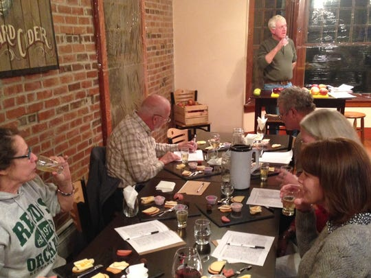 Guests enjoy the cider sampling and food pairings at Reid's Orchard and Winery.