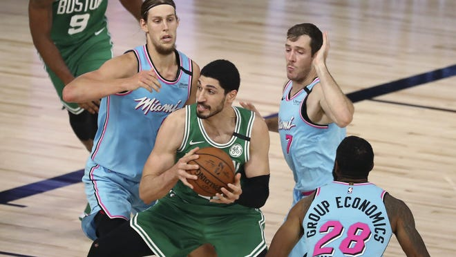 Celtics center Enes Kanter (11) drives to the basket against Heat forward Kelly Olynyk, left, guard Goran Dragic (7) and guard Andre Iguodala (28) during the second half on Tuesday night in Florida.