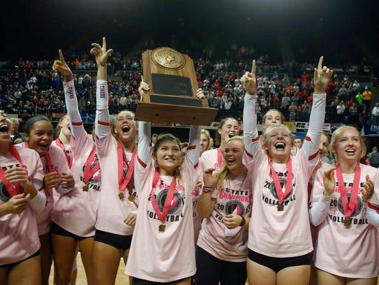 Members of the Cedar Falls volleyball team celebrate