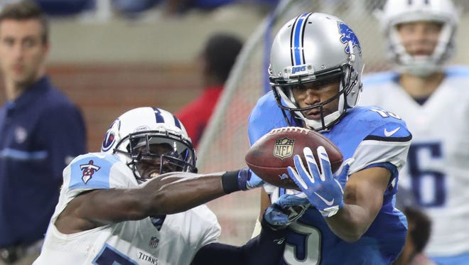 Lions receiver Golden Tate can't make the catch as Tennessee Titans defensive back Jason McCourty defends during the home opener Sunday, Sept. 18, 2016 at Ford Field in Detroit.