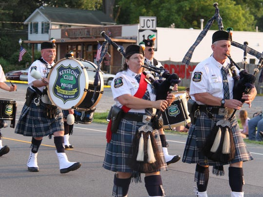 The Gates Keystone Club Police Pipes & Drums pictured in the Hamlin Firemen's Parade on Lake Road in August 2014.