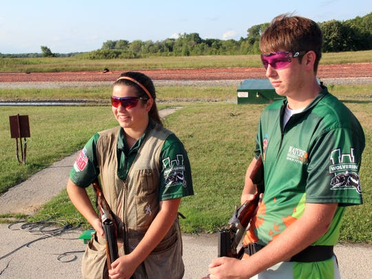 Jessie Strasser, 14, and her brother, Wyatt Strasser, 16, both of Waterford, stand on the trap range at Boxhorn Gun Club in Muskego.
