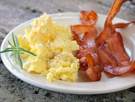 Bacon and scrambled eggs on a plate