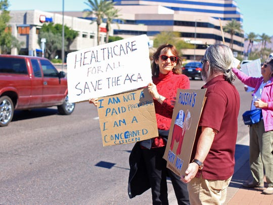 Demonstrators lined Camelback Road in Phoenix on Feb.