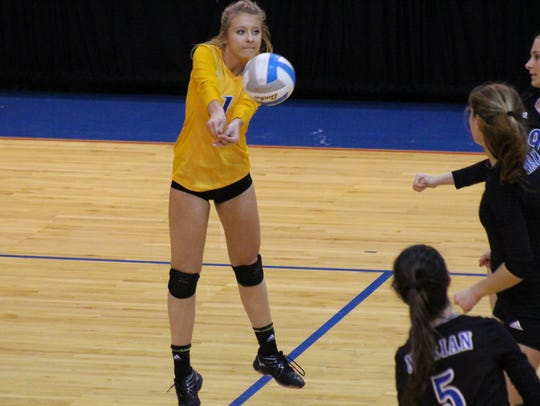Mallory Lynch of Marian gets off her feet to pass a