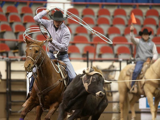 Coleby Payne of Lipan, Texas, competes in team roping on Day 1 of slack Monday inside the Foster Communications Coliseum.