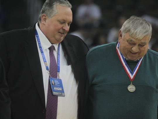 Holmes athletic director Stan Steidel was given an honorary award by KHSAA commissioner Julian Tackett at halftime during the first round of the St. Elizabeth Healthcare/KHSAA girls basketball Sweet 16 with Ryle playing Simon Kenton March 8, 2018 at BB&T Arena, Highland Heights KY.