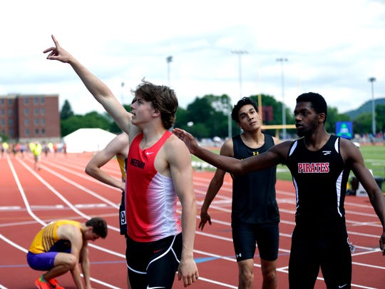 Neenah's Colin Enz points to the crowd after finishing