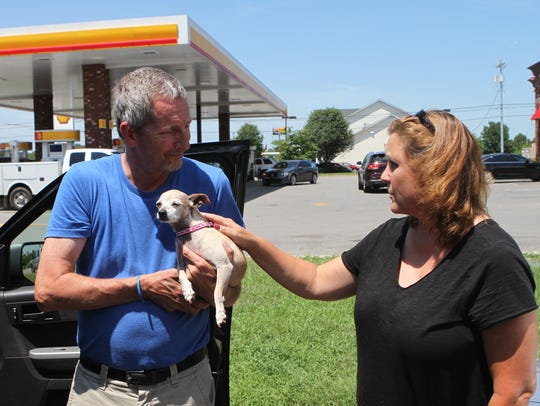Jeff Buckman, left, is reunited with Lola, a dog he