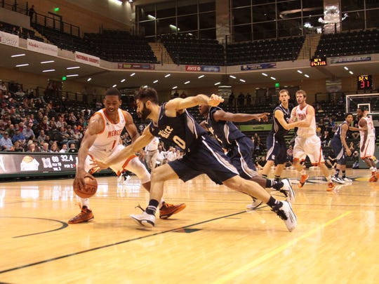 Rice guard Dan Peera strips the ball from Mercer's Phillip Leonard during overtime of their first-round game in the Great Alaska Shootout. Mercer won 77-71 at the Alaska Airlines Center in Anchorage, Alaska.