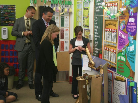 Gov. Brian Sandoval checks out a sixth-grade science project during his visit to Dayton Elementary School on March 31.