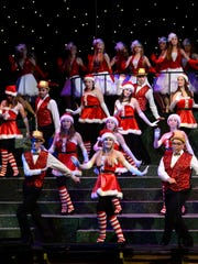 Members of the Pensacola Children's Chorus rehearse for their upcoming Christmas on the Coast production at the Pensacola Saenger Theatre.