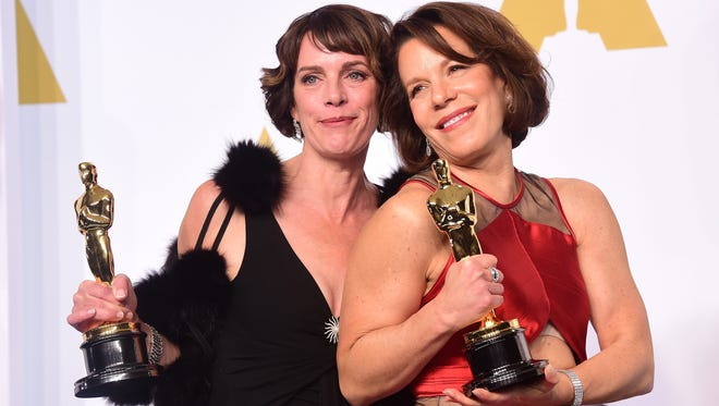 Dana Perry, left, and Ellen Goosenberg Kent pose with their Best Documentary Short Subject Oscar in the press room on Feb. 22,  2015.