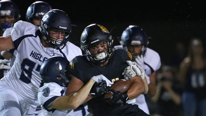 Higley's Danny Kittner (7) tackles Saguaro's La'Ray Lucas (3) during the first half at Saguaro High School in Scottsdale, Ariz. on Sept 8, 2017.