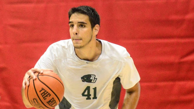 Dusan Perovic practices during a Binghamton summer workout on July 15. Perovic, a native of Montenegro, went to a prep school for two years in at the South Kent School in Connecticut to earn a college basketball scholarship.