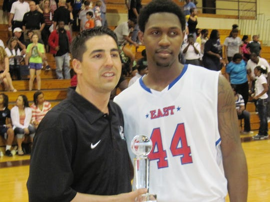 Natchitoches Central coach Micah Coleman presents Peabody star Troy Jones with the MVP trophy at the LHSCA All-Star game in Natchitoches in 2012.