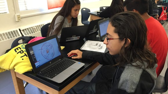Joel Aguirre, a freshman in Irvin High School's New Tech Network program, looks through his presentation for a combined health/biology class.