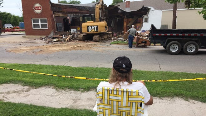Regulars of the Popp-a-Top, formerly the Overtime Tavern, had front-row seats to its demolition after a dump truck crashed into the building at 18th Street and Schuyler Avenue on June 24.