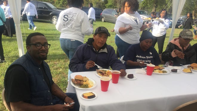 Thanksgiving dinner is served at Poindexter Park on Sunday.