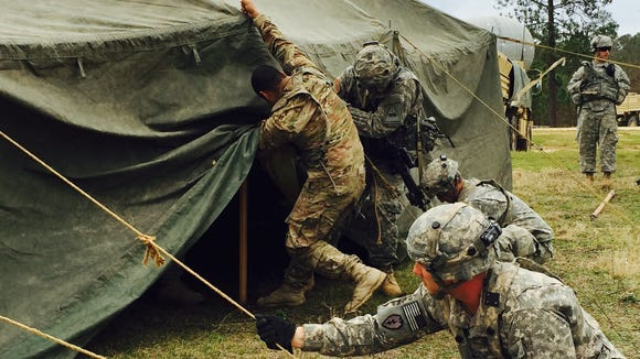 Soldiers with 1st Brigade put up tents after they moved their tactical headquarters.