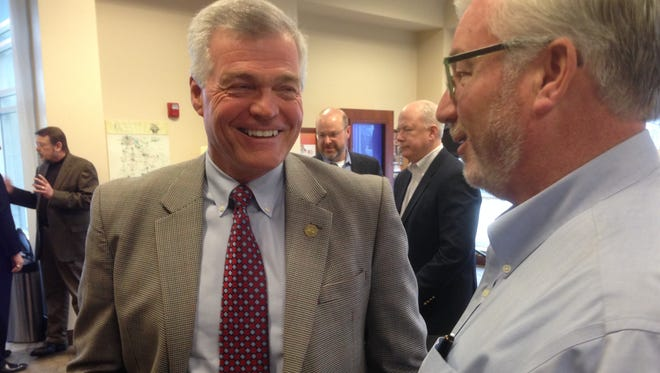 State Sen. Jim Tracy, left, discusses community issues with Chamber of Commerce Vice President of Economic Development Brian Hercules during Friday's Capitol Connection Breakfast in Murfreesboro.