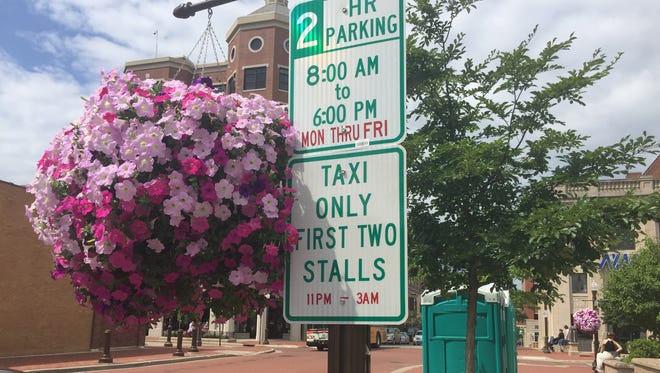 A sign marks two newly designated taxi stalls on Jefferson Street in Wausau.