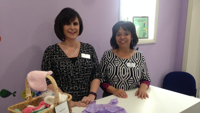 """Executive Director Linda Baylis-Spence and employee Lisa McNeal stand in the """"baby boutique"""" at the Accomack-Northampton Pregnancy Center in Onley, Virginia on Tuesday, March 21, 2017."""