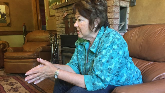 Carol Bundy sits in the living room of the Bundy family ranch in Bunkerville Nevada