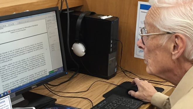 Dave Johnson of Helena uses a public-access computer recently at the State Library in Helena.