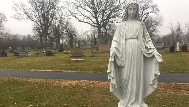 St. Mary Cemetery, on Old Romney Road in Lafayette, would border Overlook Pointe, a proposed $32 million housing development.